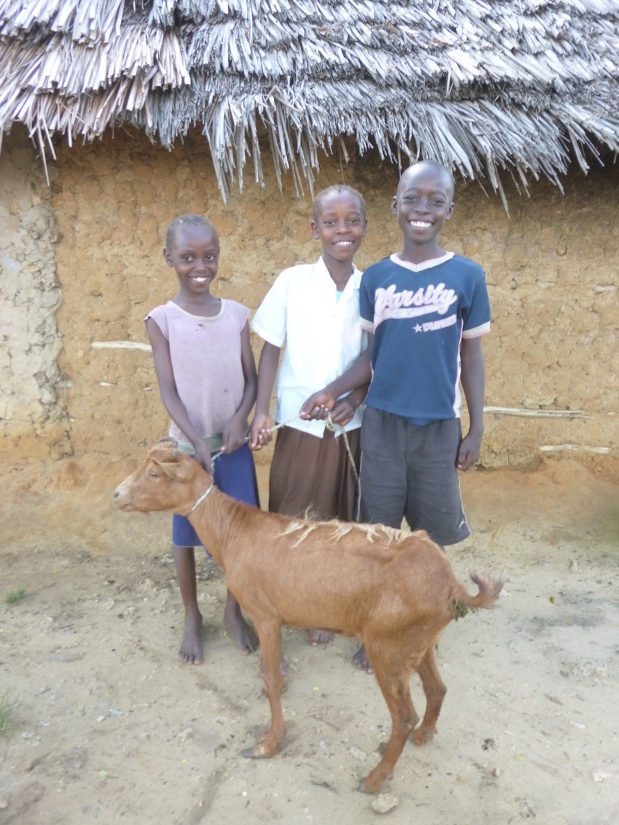 JAMES KENGA WITH SISTERS, GOAT GIFT. 2015