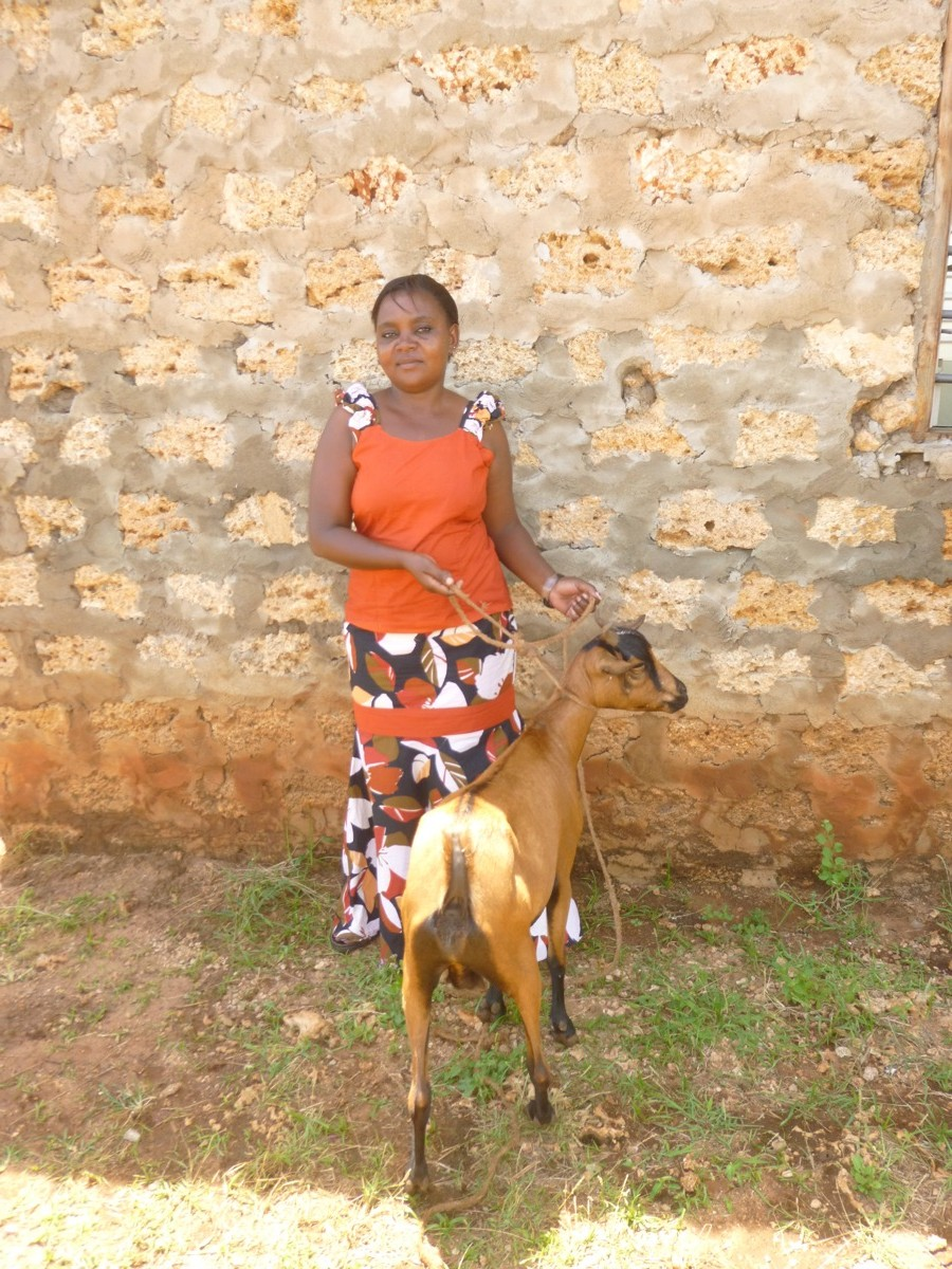 smile academy teacher with goat